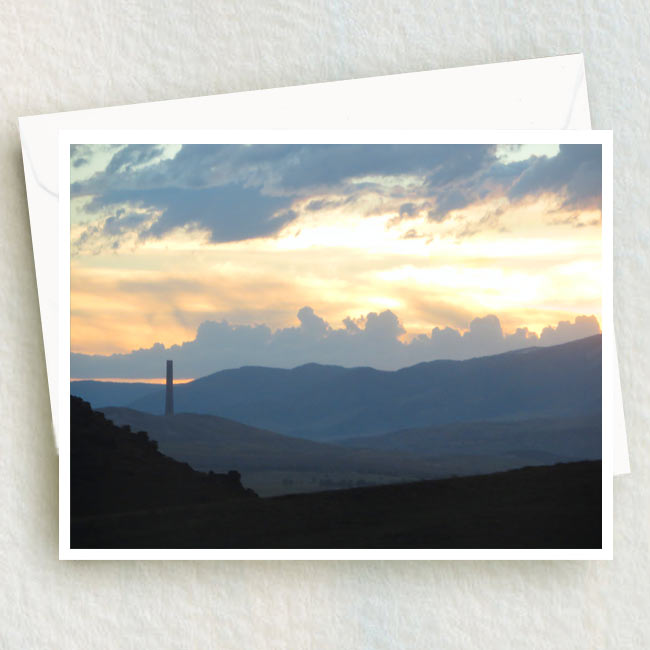 The Stack stands tall in this evening silhouette with the beautiful Montana mountains.